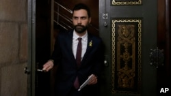 Roger Torrent, speaker of Catalan Parliament, arrives for a statement at the Catalonia Parliament in Barcelona, Spain, Jan. 30, 2018.