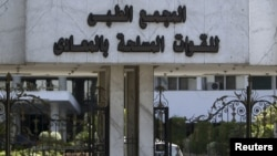Military watches Maadi hospital where Mubarak rests in Cairo.