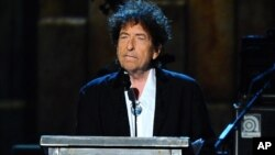 FILE - Bob Dylan accepts the 2015 MusiCares Person of the Year award at the 2015 MusiCares Person of the Year show in Los Angeles, California, Feb. 6, 2015.