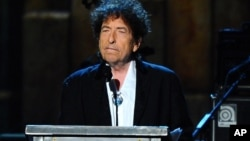 FILE - Bob Dylan accepts the 2015 MusiCares Person of the Year award at the 2015 MusiCares Person of the Year show in Los Angeles, Feb. 6, 2015.