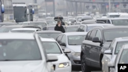 Motorists wait to cross the Croatian border from Slovenia, at Bregana border crossing, western Croatia, Saturday, Dec. 19, 2020. Balkan citizens going home from Western Europe for holidays have created huge traffic jams at border crossings despite coronav