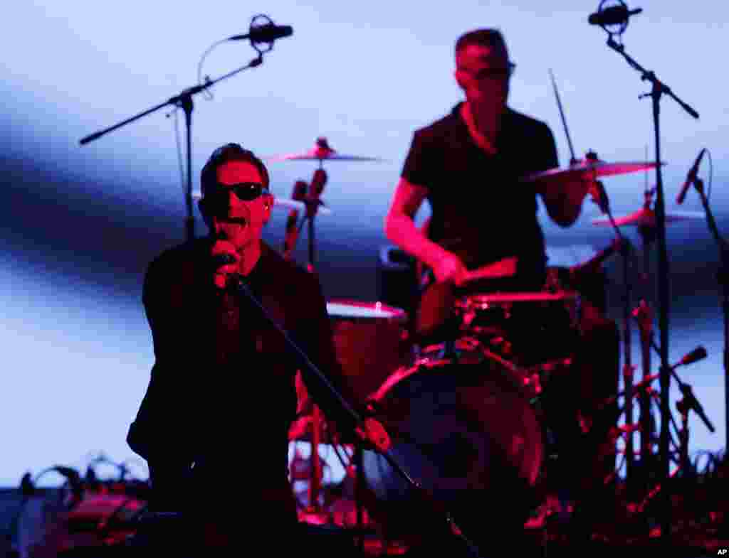 U2 members Bono (left) and Larry Mullen perform during an announcement of new products by Apple in Cupertino, California, Sept. 9, 2014.