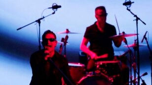 U2 members Bono, left, and Larry Mullen Jr. perform during an announcement of new products by Apple on Tuesday, Sept. 9, 2014, in Cupertino, Calif. (AP Photo/Marcio Jose Sanchez)