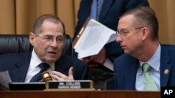 House Judiciary Committee Chair Jerrold Nadler, D-N.Y., left, and Rep. Doug Collins, R-Ga., the ranking member, talk as Nadler moves ahead with a vote to hold Attorney General William Barr in contempt of Congress on May 8, 2019. (AP Photo/J. Scott Applewh