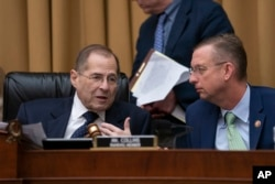 FILE - House Judiciary Committee Chair Jerrold Nadler, D-N.Y., left, and Rep. Doug Collins, R-Ga., the ranking member, talk as Nadler moves ahead with a vote to hold Attorney General William Barr in contempt of Congress on May 8, 2019. (AP Photo)