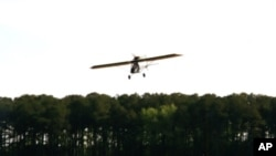 Ray Gefken takes flight in his ultralight, single-seat airplane. (Mary Saner/VOA)