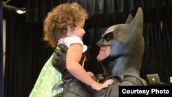 "FILE - ""Batman"" (Lenny Robinson) visiting sick children throughout the Maryland region. (Photo: Superheros for Kids)"