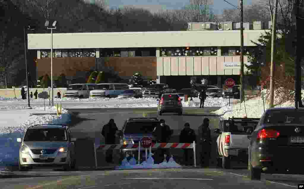 A police road block at the entrance to the new Sandy Hook Elementary School on the first day of classes in Monroe, Connecticut, January 3, 2013.