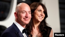 FILE - Amazon's Jeff Bezos and his wife, MacKenzie Bezos, attend the Vanity Fair party in Beverly Hills, Calif., Feb. 26, 2017, after the 89th Academy Awards.
