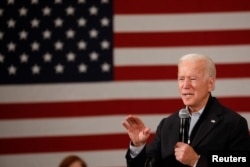 """Democratic 2020 U.S. presidential candidate and former U.S. Vice President Joe Biden speaks during a town hall meeting, during his """"No Malarkey!"""" campaign bus tour at Iowa State University in Ames, Iowa, Dec. 4, 2019."""