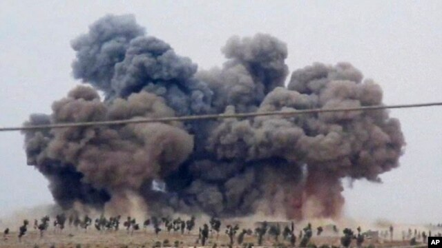 FILE - In this image made from video provided by Hadi Al-Abdallah, which has been verified and is consistent with other AP reporting, smoke rises after airstrikes in Kafr Nabel of the Idlib province, western Syria, Oct. 1, 2015.