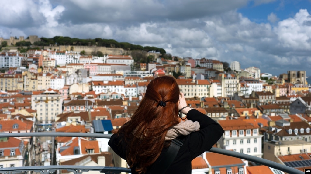 A woman takes pictures from the top of Lisbon's Santa Justa lift, April 19 2016.