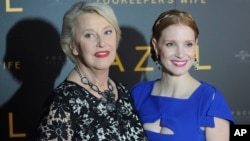 "Jessica Chastain (right) who plays the main character, and Teresa Zabinska, the daughter of Jan and Antonina Zabinski, pose at the gala screening of ""The Zookeeper's Wife,"" in Warsaw, Poland, March 7, 2017."