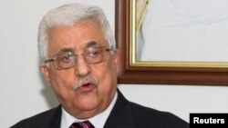 Palestinian President Mahmoud Abbas speaks during a flag-raising ceremony to inaugurate the new Palestinian embassy in Bayan, Kuwait, April 15, 2013.