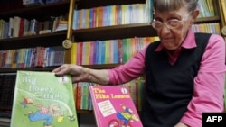 Jan Berenstain shows a copy of the first two books she and husband, Stanley Berenstain, created for children