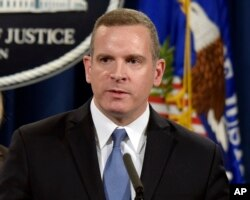 FILE - Paul Abbate, an assistant FBI director, speaks during a news conference at the Justice Department in Washington, March 15, 2017.
