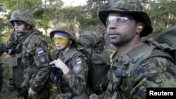 Estonia's Defense League volunteer soldiers attend a training drill near Rabasaare, Estonia, Sept. 12, 2015.