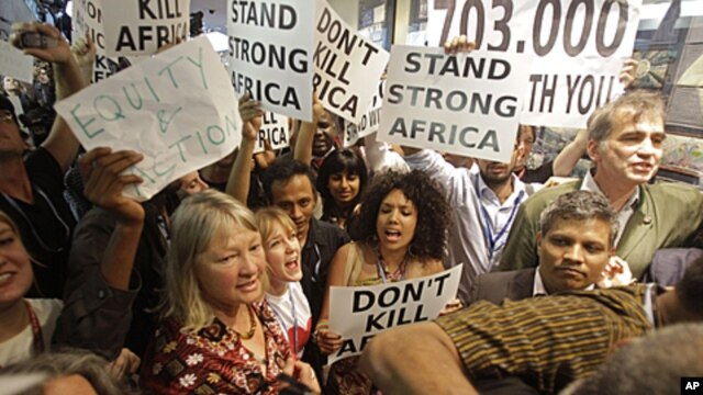 Protesters shout as they demonstrate at the climate change conference in Durban, South Africa, December 9, 2011.