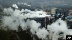 FILE PHOTO - In this Nov. 28, 2019 photo, smoke and steam rise from a coal processing plant in Hejin in central China's Shanxi Province.
