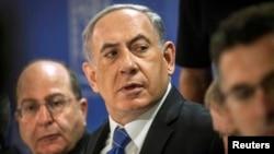 លោក Benjamin Netanyahu នាយករដ្ឋមន្ត្រីអ៊ីស្រាអែលនៅក្នុងកិច្ចប្រជុំគណៈរដ្ឋមន្ត្រីនៅក្រុង Tel Aviv កាលពីថ្ងៃទី៣១ ខែកក្កដា ឆ្នាំ២០១៤។
