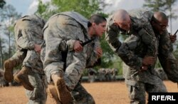 FILE - Soldiers, including a woman, participate in combatives training during the Ranger Course on Fort Benning, Georgia, April 20, 2015.