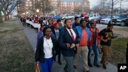 University of Oklahoma students march to the now closed University of Oklahoma's Sigma Alpha Epsilon fraternity house during a rally in Norman, Okla., March 10, 2015.