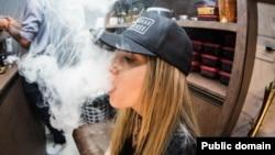 young woman vaping e-cigarette