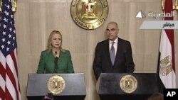 埃及電視台電視畫面顯示美國國務卿希拉里.克林頓和埃及外交部長阿姆魯宣佈以色列和加沙停火