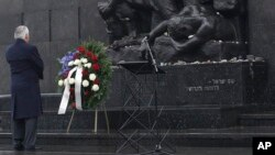 U.S. Secretary of State Rex Tillerson lays a wreath during a ceremony at the Warsaw Ghetto Uprising 1943 memorial marking International Holocaust Remembrance Day, in Warsaw, Poland, Jan. 27, 2018.