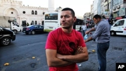 Unemployed Jordanian Hisham al-Halawani, 24, stands on a street in downtown Amman, May 20, 2015.