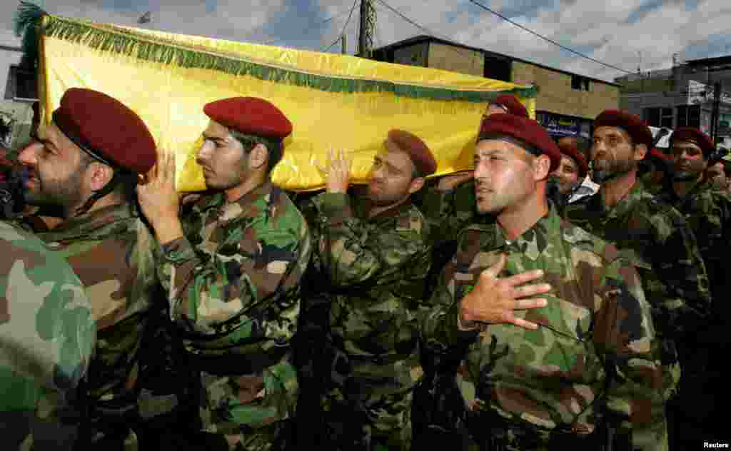 Supporters and relatives of Hezbollah members attend the funeral of a Hezbollah fighter who died in the Syrian conflict. The funeral took place in the Ouzai district in Beirut, May 26, 2013.