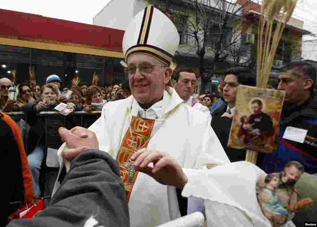 Then Archbishop of Buenos Aires Cardinal Jorge Bergoglio greets people during the annual gathering and pilgrimage to the church dedicated to Saint Cajetan in Buenos Aires, August 7, 2009.