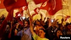 Des manifestants marchent dans les rues de Tunis, en Tunisie, le 17 juillet 2014.