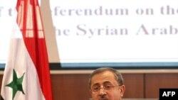 Sirijski ministar unutrašnjih poslova Mohamed al-Šar objavljuje rezultate referenduma na konferenciji za novinare u Damasku