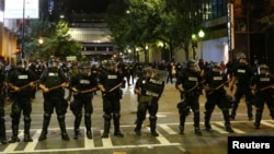 FILE - Police hold their lines in uptown Charlotte during a protest of the police shooting of Keith Scott in Charlotte, North Carolina, Sept. 21, 2016.