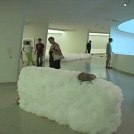 Opposites coexist in these Lee Ufan sculptures where heavy rocks and steel are held in the air by clouds of cotton.