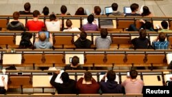 FILE PHOTO: Students attend a lecture in the auditorium of a university in Munich, Germany, May 25, 2016.