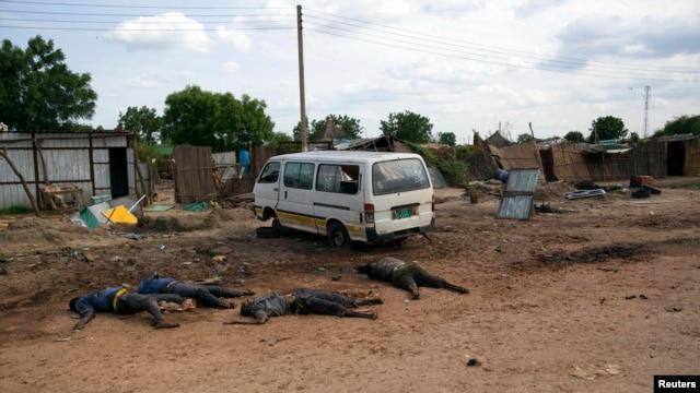 Slain bodies of civilians killed in renewed attacks lie along a road in Bentiu, Unity state of South Sudan, April 20, 2014.
