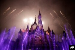 Fireworks are set off near the Enchanted Storybook Castle at the Shanghai Disney Resort in Shanghai. The Disney theme park is scheduled to open on June 16 this year, photo taken on May 31, 2016.