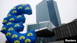FILE - Inflated euro sign is seen outside the new headquarters of the European Central Bank in Frankfurt, January 2015.