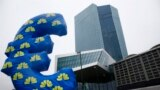Inflated euro sign is seen outside the new head quarters of the European Central Bank (ECB) in Frankfurt, Jan. 22, 2015.