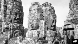 Brooding stone faces look down on the Bayon Temple in the ruins of Angkor, the ancient capital of the Khmer Empire in Cambodia on July 5, 1960. The identical faces, all bearing the same smile, are said to be symbols of Jayavarman VII, the last great build