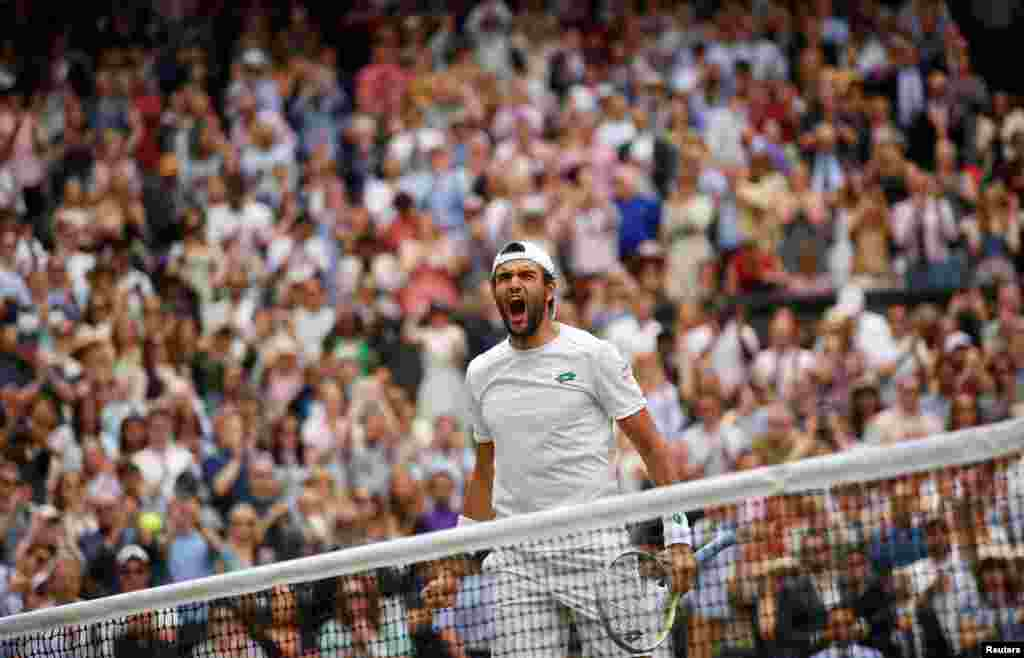 Italy's Matteo Berrettini celebrates after defeating Poland's Hubert Hurkacz during the men's singles semifinals match of the Wimbledon Tennis Championships in London.