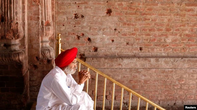 A Sikh man sits beside the wall of one of the complex of Golden Temple hit by the bullet shots during the operation Blue Star in the northern Indian city of Amritsar on June 6, 2010. Indian troops stormed the Golden Temple, the Sikhs' holiest shrine, on June 6, 1984.