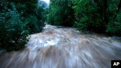 Boulder Creek roils at high speed after days of record rain and flooding, at the base of Boulder Canyon, Sept. 13, 2013, in Boulder, Colorado.