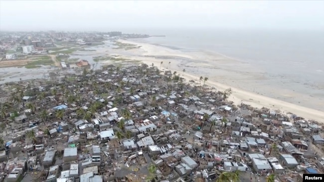 FILE - Drone footage shows destruction after Cyclone Idai in the settlement of Praia Nova, which sits on the edge of Beira, Mozambique, March 18, 2019.