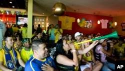 Vuvuzelas added to the festive atmosphere at Caf'e Belo when Brazil won its game