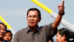 "FILE - Cambodian Prime Minister Hun Sen, shown delivering a speech in Phnom Penh in January, calls Sam Rainsy, head of the opposition Cambodia National Rescue Party, a ""traitor's son."""