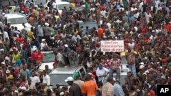 Protesters gather as thousands rally to call for the departure of South African company Waymark, which was hired by the Guinean government to re-do the country's electoral list, in Conakry, Guinea, September 20, 2012.