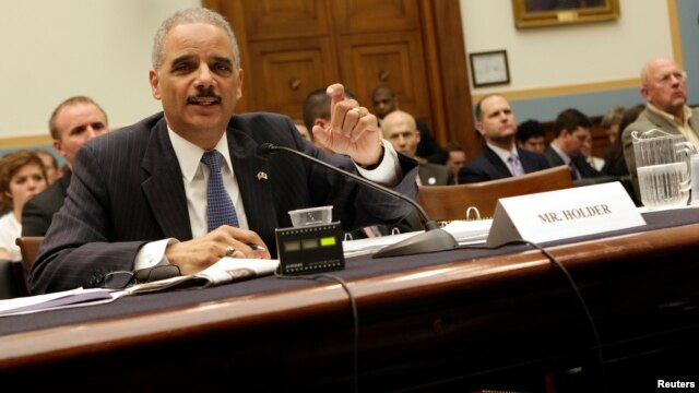 "U.S. Attorney General Eric Holder testifies before a House Judiciary Committee hearing on ""Oversight of the United States Department of Justice"" on Capitol Hill in Washington May 15, 2013."